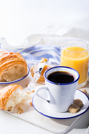 Croissant with Jam Espresso Coffee and a glass of Orange Juice Tradition of the Sunset Morning Baking Sweet Dessert Stock Photo