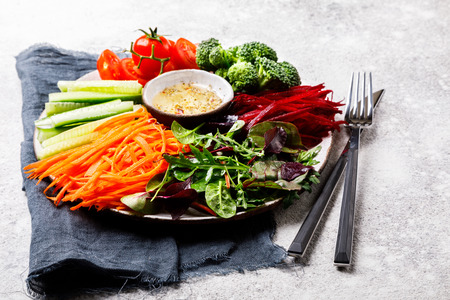 Salad Vegetables on a Plate and Stone Background with mustard sauce Vegetarian Food or Healthy diet concept  Super Food Bowl of Buddha