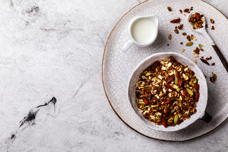 Granola cinnamon with milk on a marble Background. Breakfast  Healthy Food. Diet Nutrition Concept.  Top View. Flat Lay.Copy space for Text. Фото со стока