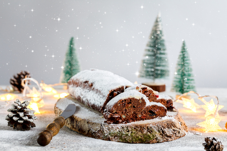 Christmas or New Year pastries Holidays Concept Dresdnen Stollen Chocolate Traditional German Cake Gift Fruit Cake Holiday Standard-Bild