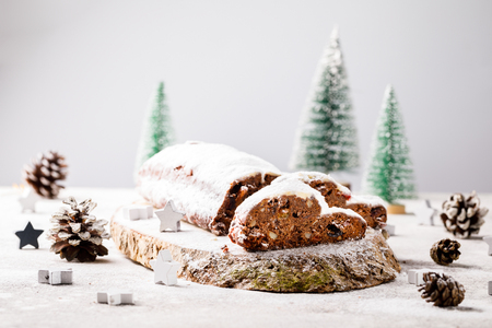 Christmas or New Year pastries Holidays Concept Dresdnen Stollen Chocolate Traditional German Cake Gift Fruit Cake Holiday Stock Photo