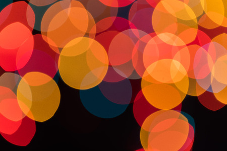 Bright  Abstract Blurred colored on black Background Holiday Bokeh . Christmas wallpaper decorations concept