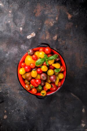 Cherry tomatoes. Summer useful vegetable for vegetarians. Variety of colors and tastes. 写真素材