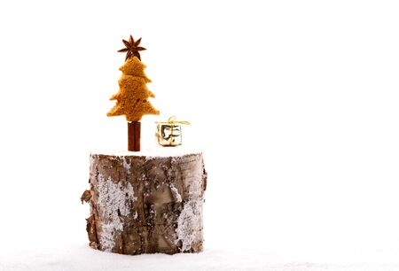 Christmas Decoration.Gingerbread in the shape of a Christmas tree on a stump.Concept of a Holiday and New Year.