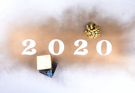 Happy New Year 2020 . Festive Shining  composition on  gold background .Flat lay, top view, copy space. Reklamní fotografie