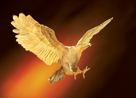 golden eagle flying against abstract background