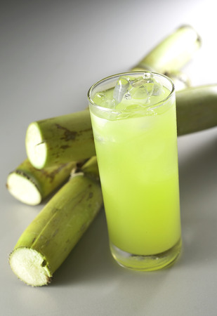 sugar cane juice surrounded by sugar cane Standard-Bild