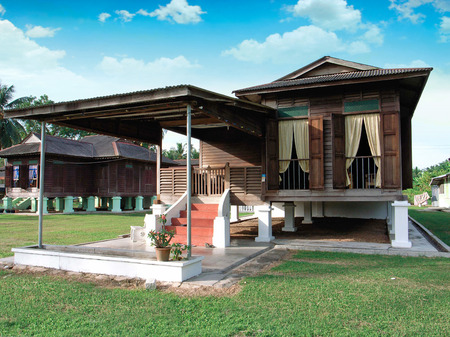 kampung: traditional malay wooden house in village                                                  Editorial