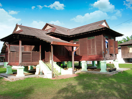 malay village: traditional malay wooden house in village