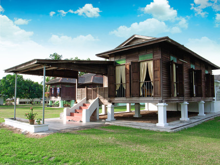 kampung: traditional malay wooden house in village