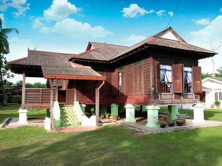 malay village: traditional malay wooden house in village                                                    Editorial
