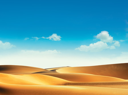 desert sun: Desert and blue sky with clouds Stock Photo