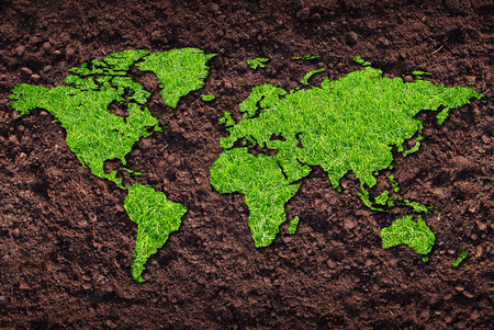 south africa soil: Grass of world map on soil background Stock Photo