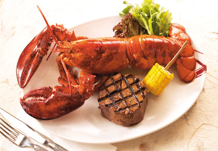 lobster dinner: Lobster and steak Stock Photo