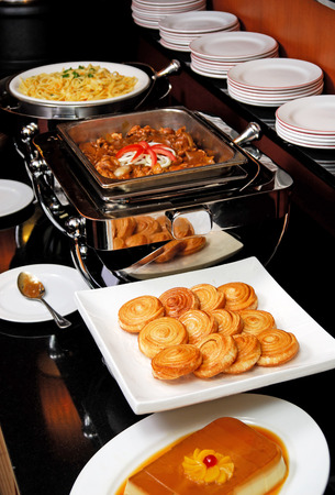 catering food: Buffet line with different dishes