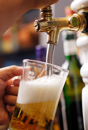 pouring beer: Pouring beer into glass