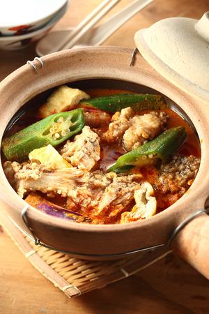 malaysia culture: Claypot curry fish head