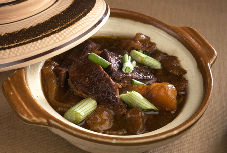 sauce dish: Stewed assorted meats and seafood in clay pot Stock Photo