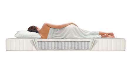 Woman sleeping on pocket spring mattress Reklamní fotografie - 81814172