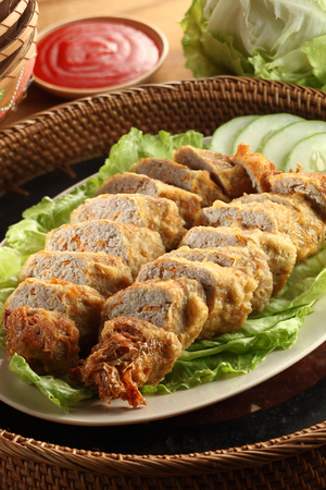 Chinese cuisine spring rolls with sauce Stock Photo