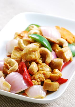 Asian cuisine stir fried chicken with peppers and cashew nuts