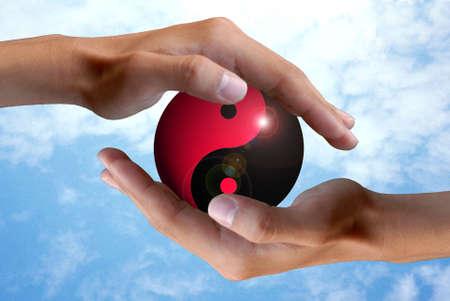 ying yang: hand with ying yang
