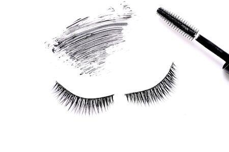Mascara brush with mascara stroke and fake false eyelashes on white background 스톡 콘텐츠