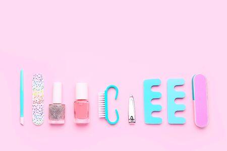 Pedicure set on light pink background