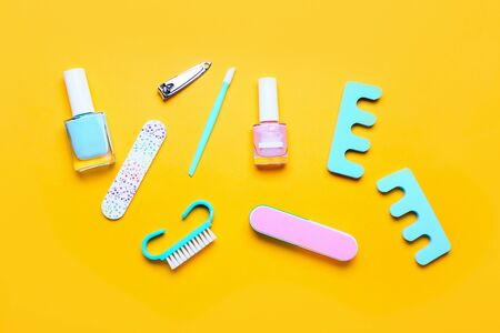 Pedicure set on bright yellow background