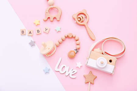 Set of baby stuff and accessories on light pink and white background. Baby shower concept. Fashion newborn. Flat lay, top view Stockfoto
