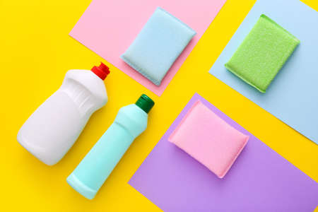Colorful cleaning set for different surfaces in kitchen on yellow background. Top view, flat lay Reklamní fotografie