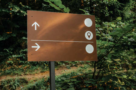 Broen track pointer in the deep forest. The abstract concept for different choice, decision, or the distinctive opinion. Reklamní fotografie