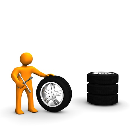 A figure of a man with wrench and a stack of tires.  photo