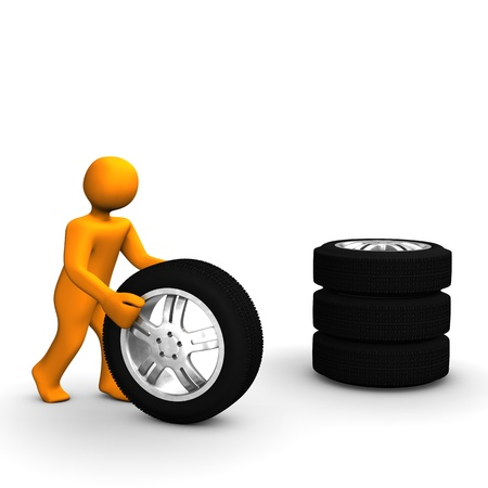 orange man: A figure of a man with a stack of tires.  Stock Photo