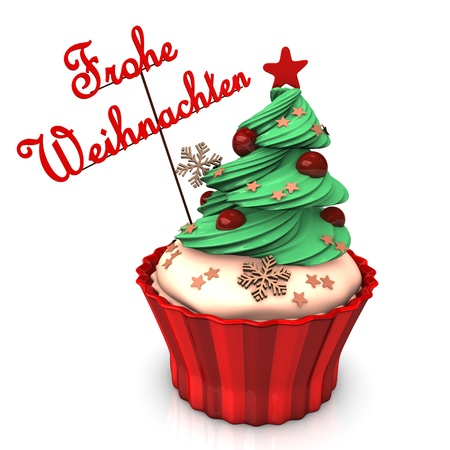 A christmas cupcake with green tree and german text Merry Christmas photo