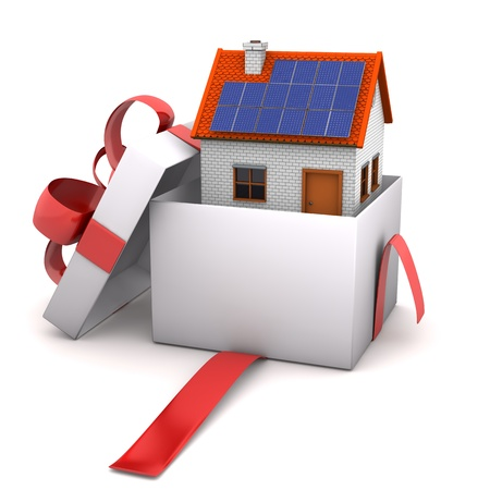 Opened gift with house on the white background. Stock Photo