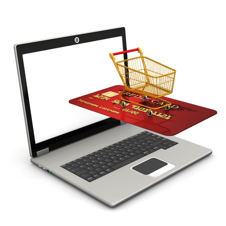 Laptop with red credit card and shopping carry. White background. photo