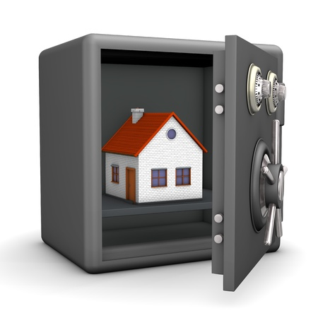 A house in the opened safe  White background  photo