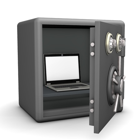 A laptop in the opened safe  White background  photo