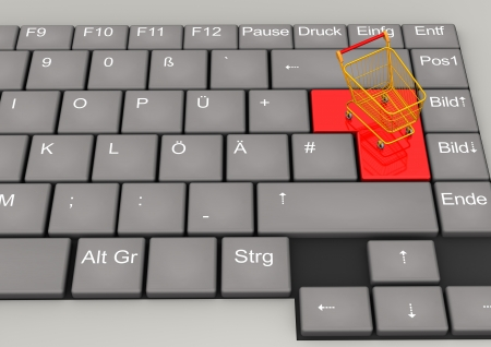 German keyboard with small orange shopping cart  photo