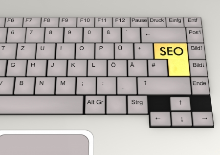 German keyboard of a notebook with golden key SEO  photo