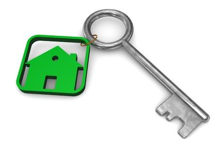 Symbol of house with iron key  White background  photo