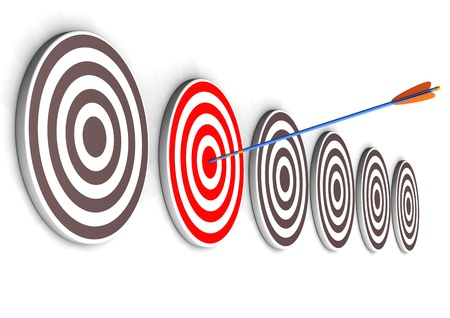 One arrow in the right target bullseye  White background  photo
