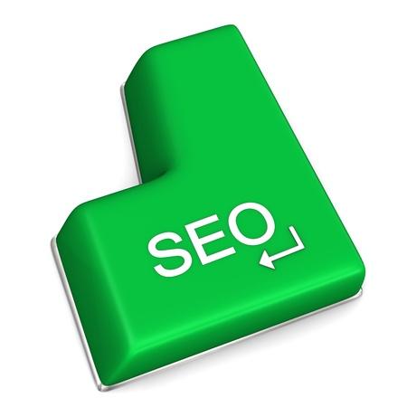 keywording: Green enter key with text SEO on the white background.