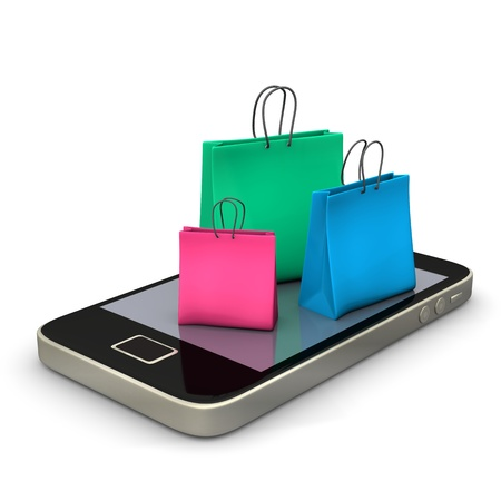 buying online: A smartphone with three colorful shopping bags  Stock Photo