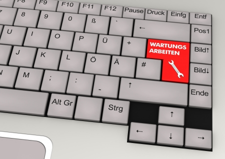 Keyboard with red key and german text  wartungsarbeiten  translate  maintenance   photo