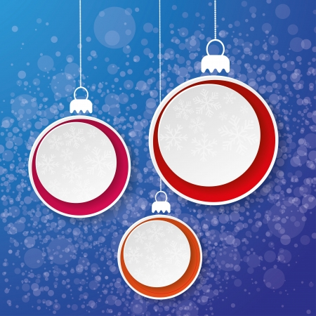 Three paper christmas bauble with snowflakes on the blue background. photo