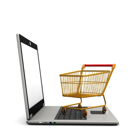 Laptop with shopping cart on the white background. photo
