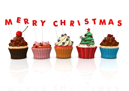 Colorful cupcakes with red text Merry Christmas. photo