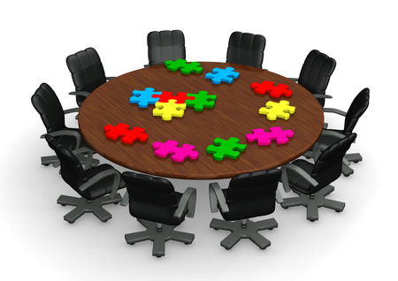 Conference tabel with colored puzzle pieces on the white background. photo
